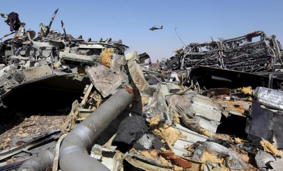 The remains of a Russian airliner are seen as an Egyptian military helicopter flies over the crash site in Egypt, Nov. 1, 2015. REUTERS
