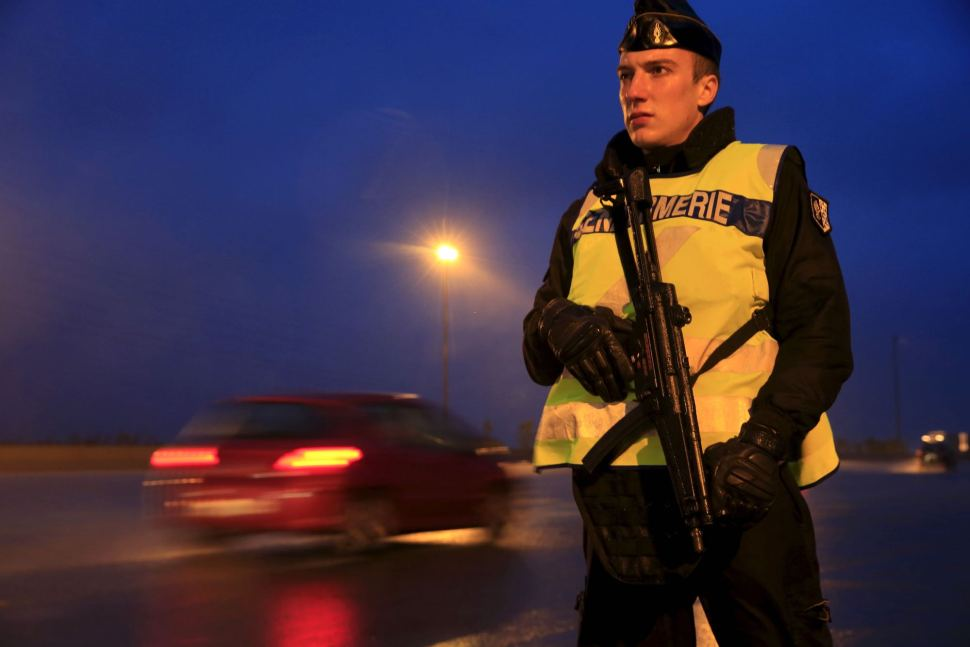 An armed French gendarme stands along the highway as gendarmes check vehicles and verify the identity of travellers in France, Nov. 19, 2015 [Reuters]