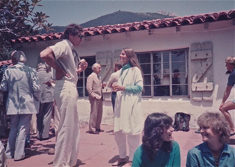 Patio scene with Carl Ruck and Joan Halifax in foreground. Albert Hofmann in the background.