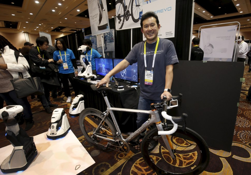 "Satoshi Yanagisawa of Japan displays the Orbitrec, a connected 3D printed bicycle by Cerevo, during ""CES Unveiled,"" a preview event of the 2016 International CES trade show, in Las Vegas, Nevada January 4, 2016. The bicycle features 3D printed titanium joints, carbon fiber tubes and a built in sensor module that sends a variety of information to a smartphone. REUTERS"