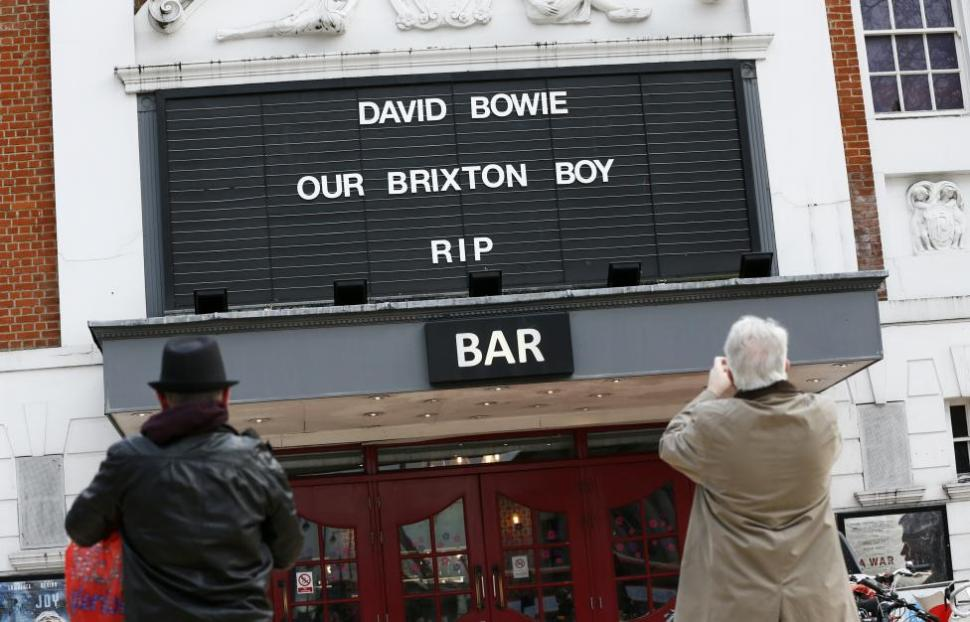 A tribute to David Bowie is seen on a local cinema in Brixton