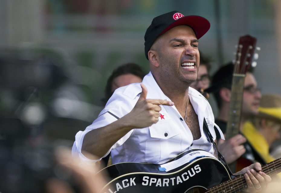 Rage Against the Machine guitarist Tom Morello addresses a crowd including members of Occupy Wall Street, labor unions and immigration rights demonstrators in Union Square, during a May Day demonstration in New York, May 1, 2012. Thousands packed New York's Union Square in a festive atmosphere with Morello leading a sing-along. REUTERS/Lucas Jackson