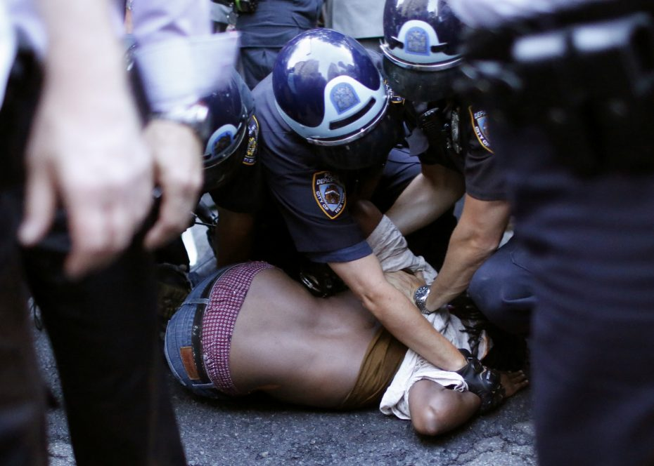 A protestor is detained by NYPD officer as people take part in a protest for the killing of Alton Sterling and Philando Castile during a march along Manhattan's streets in New York July 7, 2016. REUTERS/Eduardo Muñoz