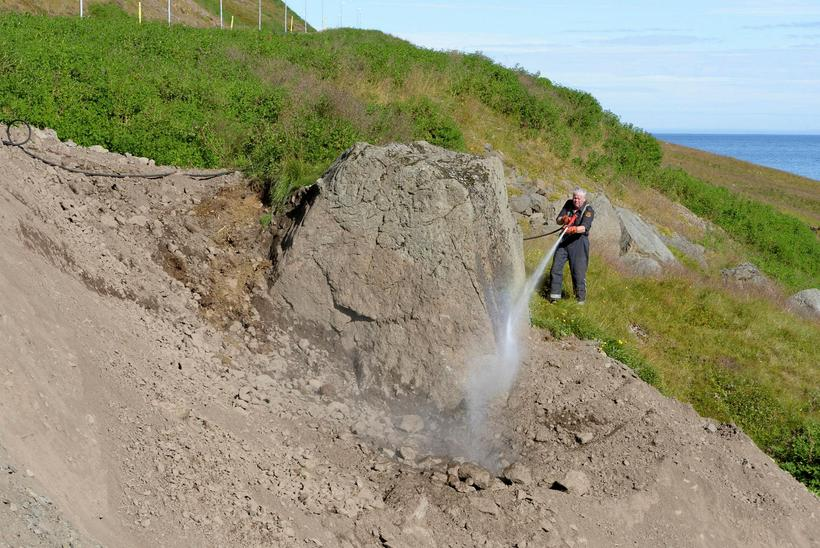 The rock being hosed down and cleaned