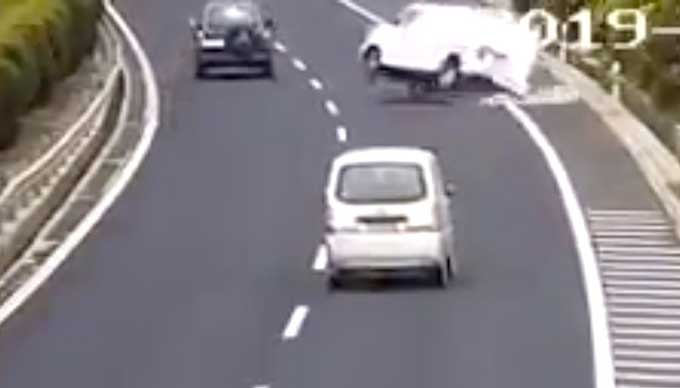 Driver misses freeway exit, causes another car to flip, then merrily drives off