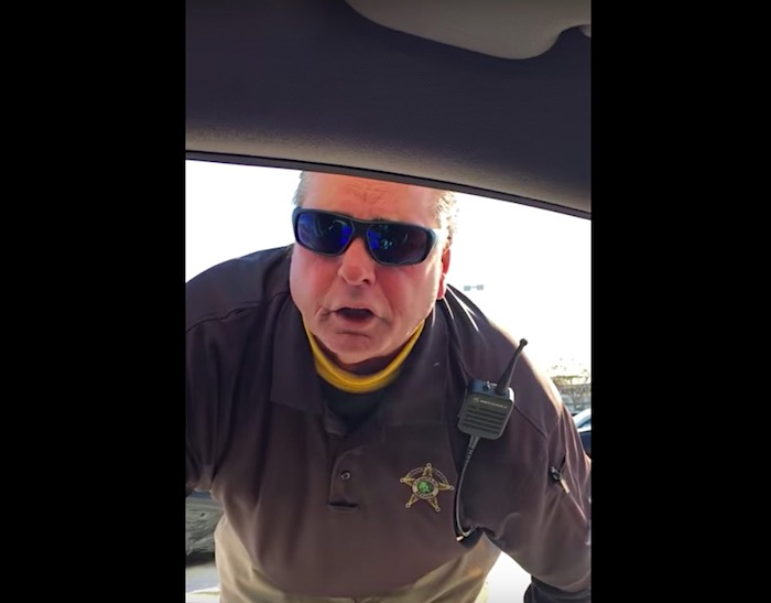 """A racist cop bullies two black men for """"acting suspicious,"""" and he actually gets fired"""