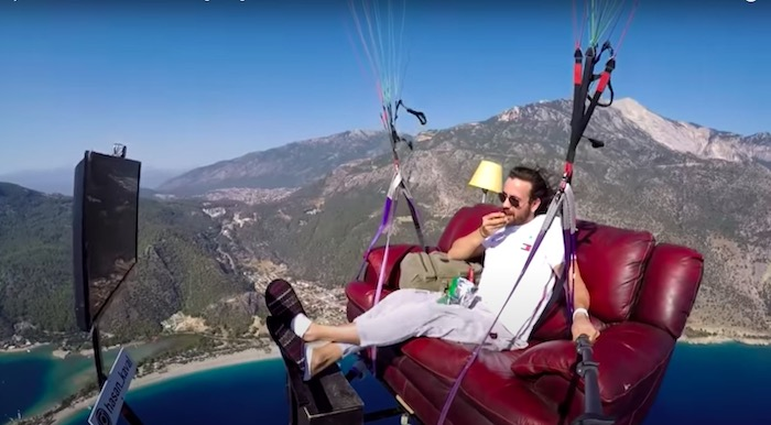 Paraglider takes off on his couch eating chips and drinking soda