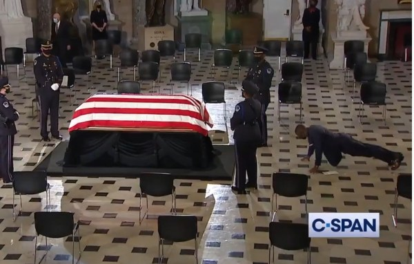 Ruth Bader Ginsburg's personal trainer honors her memory by performing pushups by coffin in U.S. Capitol