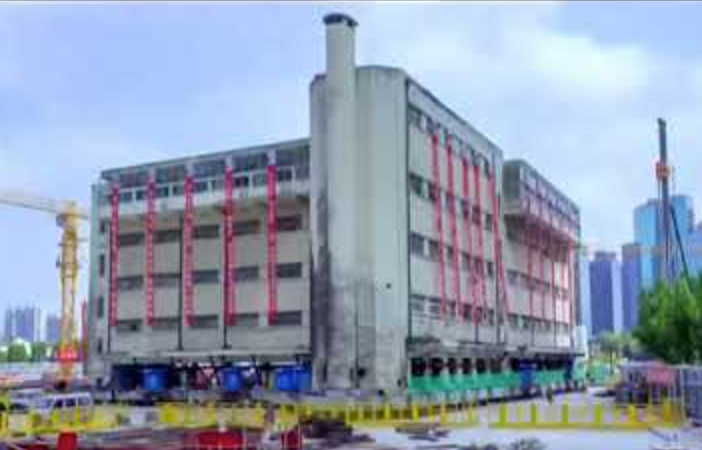 Watch huge building mechanically walk to its new location | Boing Boing