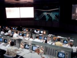 Screenshot of Mission Control at NASA, from a video by Fran Blanche