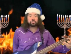 Man plays bass in front of menorahs