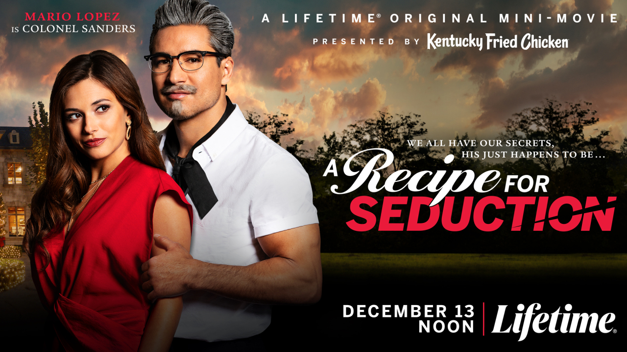 Mario Lopez dressed as Colonel Sanders holds a woman against a dramatic backdrop