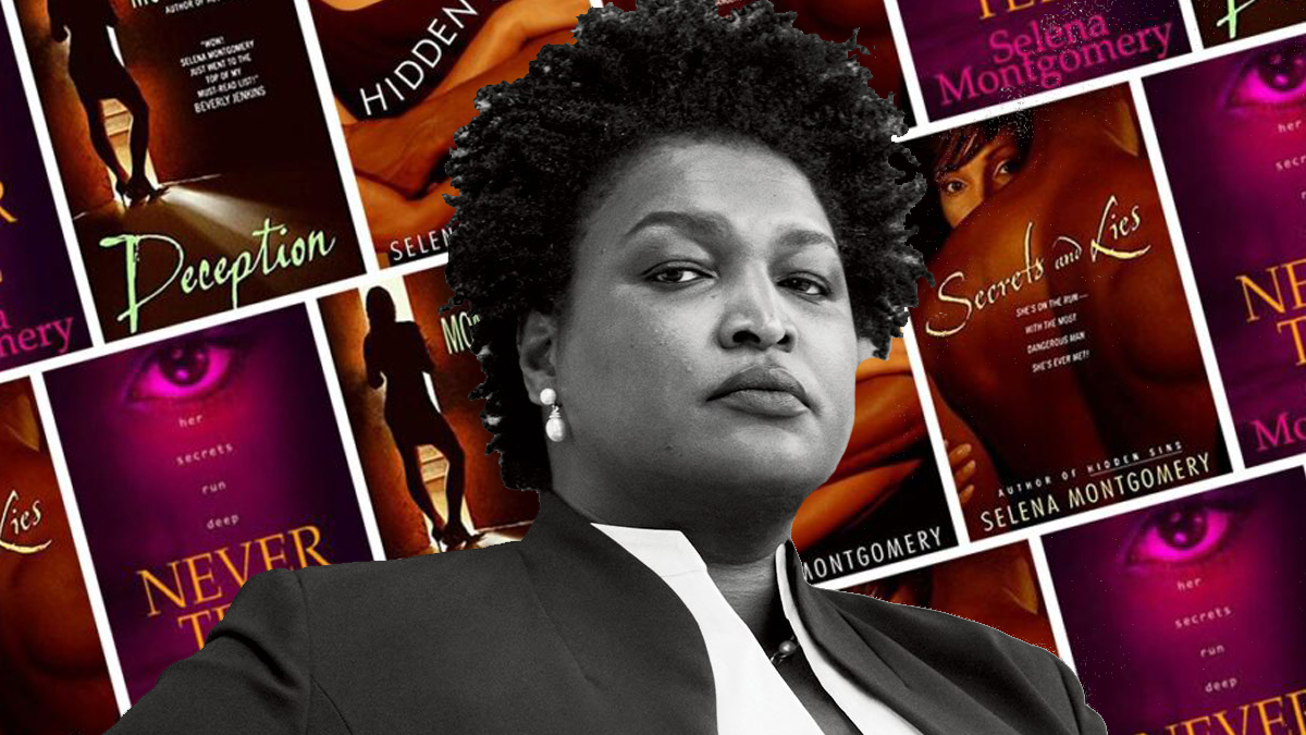 stacey abrams in front of romance novels