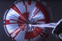 Screenshot of NASA video showing Perservance's parachute opening up