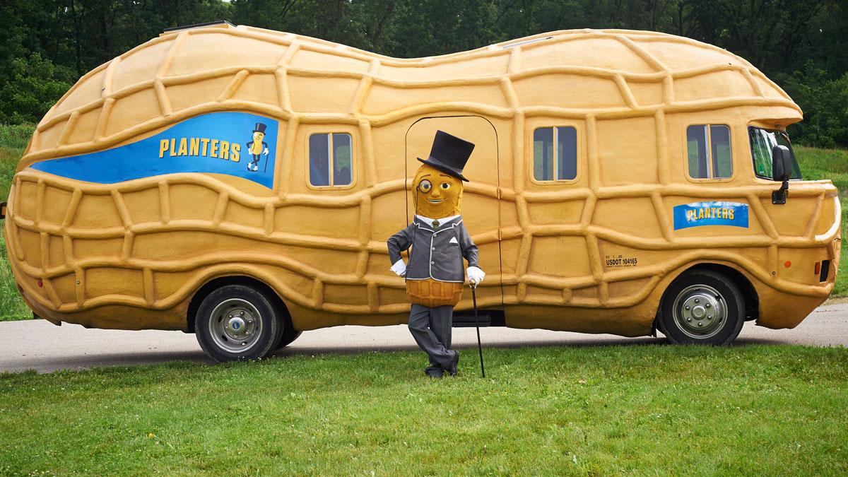 A car shaped like a peanut with the Mr. Peanut mascot
