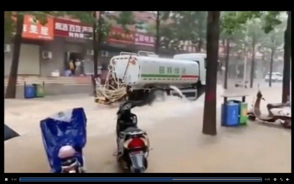 Why the hell is this street sprinkler truck in China spraying water in flooded street?   Boing Boing