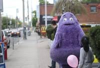Photo of Grimace on city street, by Danielle Scott