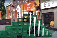 Screenshot of video of a woman climbing milk crates in the