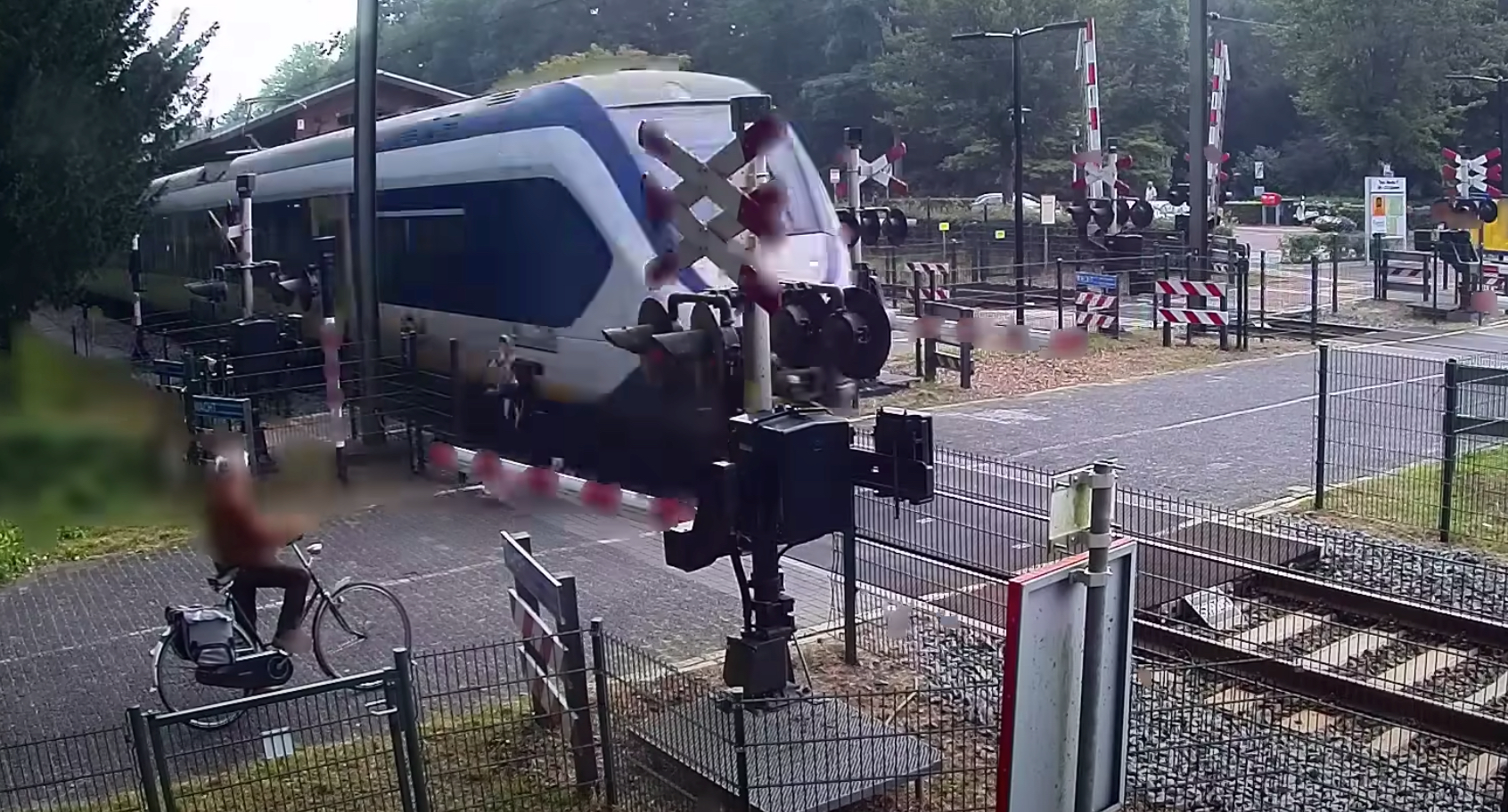 Watch this woman barelyjust barelymiss getting hit by a train
