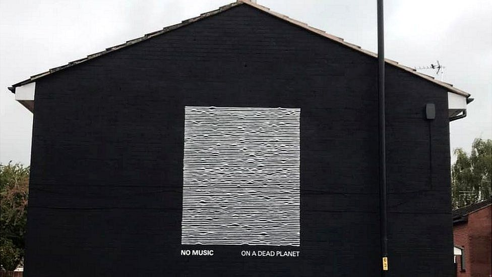 New climate change mural by Joy Division artist riffs on his famous album cover