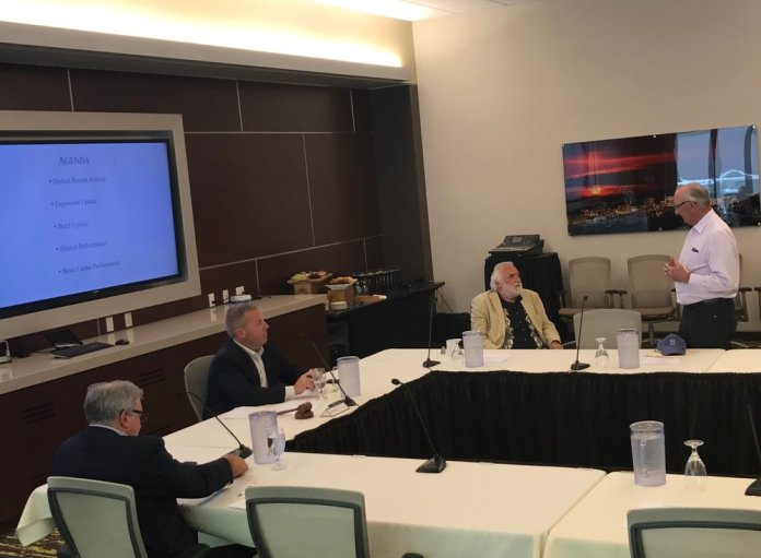 Gary Michael addresses members of the GBAD board before the formal start of their meeting Wednesday