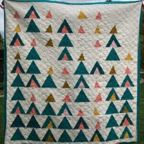 quilt featuring triangle shapes to resemble mountains