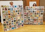 holding up a hexi quilt