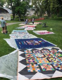 quilts displayed in the park