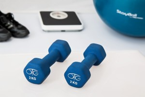 Image of sneakers, hand weights, scale and exercise ball