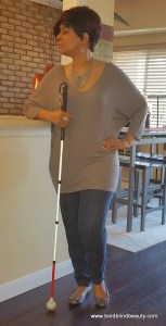 Here I am standing with my white cane in front of my breakfast counter.
