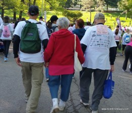 Survivor holding hands and in the middle of her son and husband.