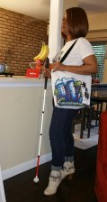 I am posing in an Abigail Style tee while holding the white tote bag with black handles.