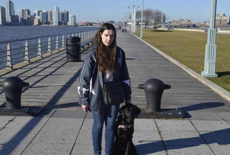 BlindBeader and her guide dog, Jenny at a pier in New York