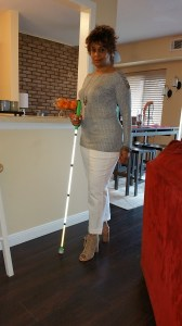 I'm posing for the camera standing with my white cane prior to leaving for the evening.