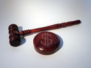 Gavel and block embossed with a dollar sign
