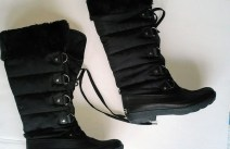Black faux-fur lined and trimmed lace-up knee-high winter boots
