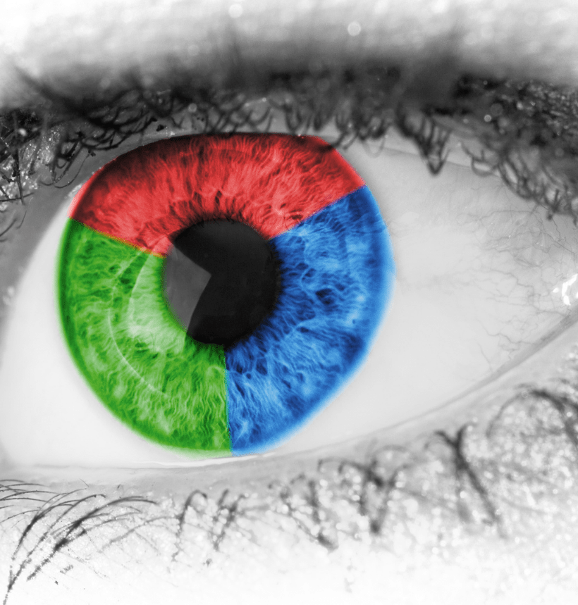 Black and white photo of an eye with red, blue, and green primary colors for the iris.