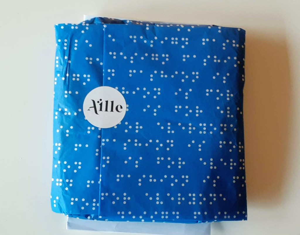 Braille tissue wrapped tee and mask