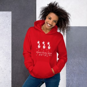 "Red hoodie w/white ink. There is an Abby trio front and center. Directly under the trio is the slogan with the word ""Attitude"" in braille (non-tactile)."