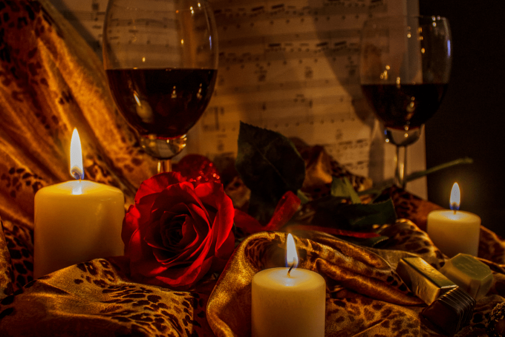 Creating Your Self-Image romantic photo representing leading with the heart is a romantic photo wine, roses, candles, chocolates, sheet music, and lingerie.