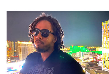 The header is a photo of Jahron an attractive African American man with dreadlocks and wearing sunglasses. A nighttime cityscape is in the background