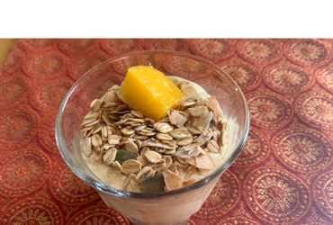 "The Ultimate Smoothie Template: Alicia Connor's ""Mango Lassi"" Smoothie, topped with a couple of tablespoons of ""no-sugar-added granola"" (contents: toasted oats & coconut, raw pumpkin seeds, and cinnamon) and a piece of fresh mango."