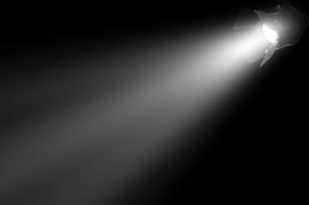 Featured In: An image of an illuminated spotlight in the dark.