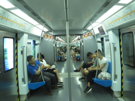 A rare moment on the Beijing metro, with everyone seated