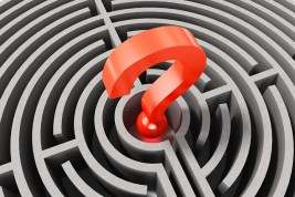 Red question mark image in a maze. Not sure how to build and make your WordPress website work. we can help.