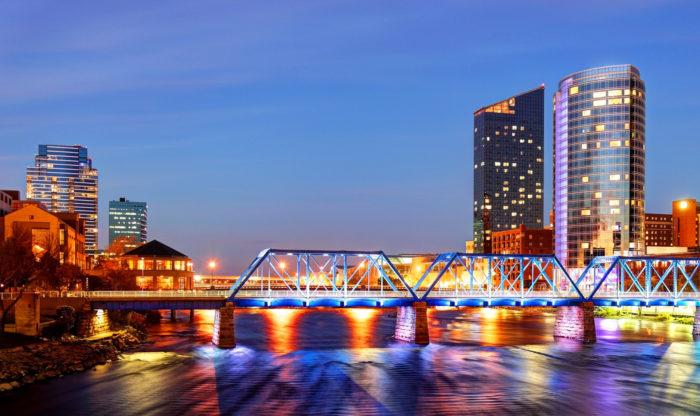 Grand Rapids Michigan skyline along the banks of the Grand river   Bold Orange