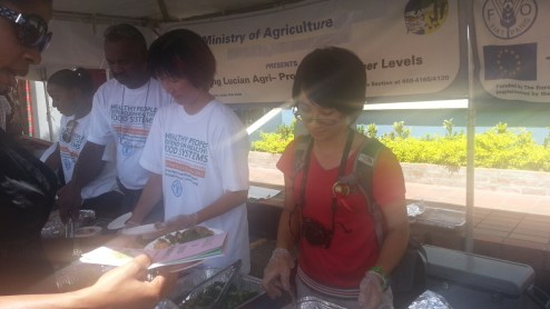 Ministry of Agriculture and FAO passing out mini meals and cookbooks (for sale)