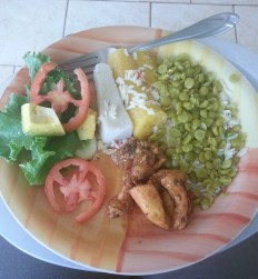 salad, chicken, ground provisions, rice and lentils