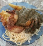 Callaloo (green stuff), crab legs, noodles, mac n cheese, and ground provisions