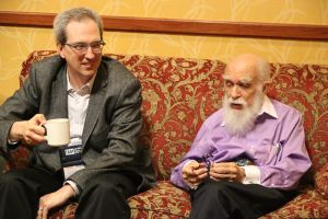 """David Gorski and James Randi sitting on a love seat together at the 2014 """"Amazing Meeting"""" - Photo by Susan Gerbic."""